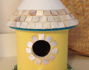 Yellow circular bird house