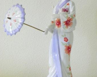 Japanise holding umbrella vintage figurine