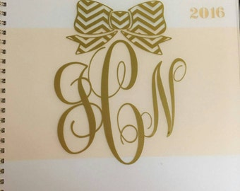 Cursive monogram with patterned bow