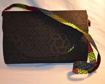 "NEW** ""Ibidun"" Ankara print convertible handbag mixed with textured black fabric."