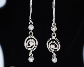 14kt white gold swirly / diamond drop earrings