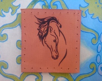 Leather horse patch.
