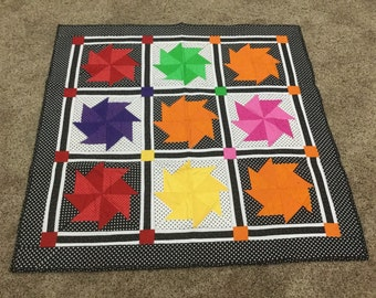 Polka Dotted Bright Pinwheel Baby Quilt