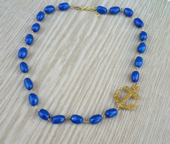 New 1940s Costume Jewelry: Necklaces, Earrings, Pins Anchor Necklace Nautical Jewelry Blue Beaded Necklace Gold Anchor Necklace Blue Statement Necklace Pin Up Rockabilly Jewellery $18.17 AT vintagedancer.com