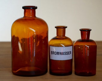 3 vintage apothecary bottles in different sizes, 1950s