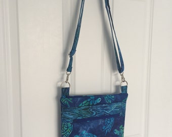 Handmade multipocketed fabric purse. Over the shoulder or crossbody adjustible strap.