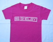 Kids Carroll Shelby pink youth child t-shirt