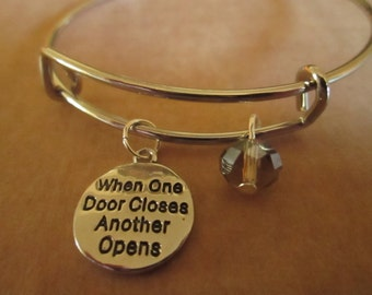 Adjustable Bangle Bracelet with 'When One Door Closes, Another Opens' Charm and Gold Faceted Bead
