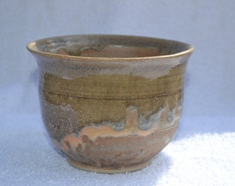 Yellow-Brown Ceramic Bowl with Running Glaze
