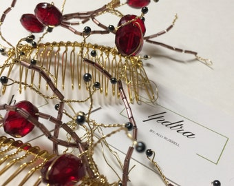 Winter branches. Hair comb. Red.