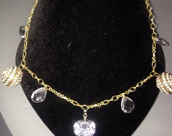Gold necklace with crystals.