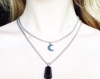 Necklace in black onyx with growing Moon pendant