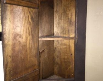 Prim corner cupboard