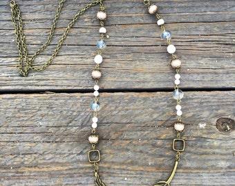 Sideways brass feather pendant necklace