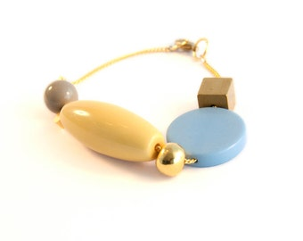 Color block asymmetric beaded Bracelet / spring 2016 / blue yellow gold Design 60