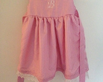 Girl/boy dresses and rompers.  Your choice size and color  22.00 up.  Monogramming extra.