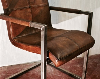 Tan leather chair with Brushed Steel Frame