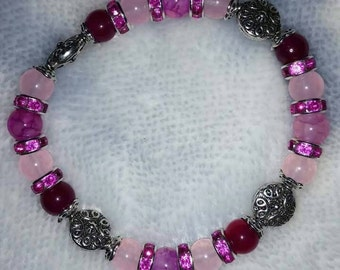 Pinks and silver bracelet.