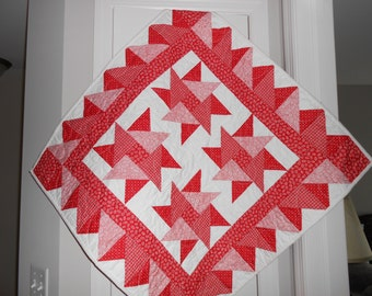 Red and white spinning stars quilted wall hanging!