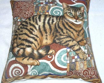 Tabby cat sitting on a mosaic patterned rug in a wicker basket cushion