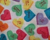 Valentines Fabric/Conversation Hearts/Pink, blue, green and yellow hearts/ Glitter on fabric/Cotton/By the Yard