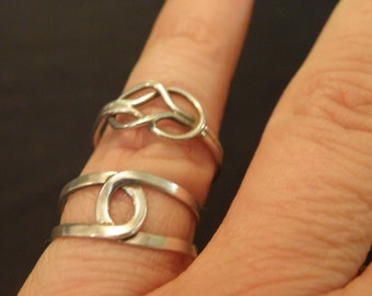 Two silver knot rings