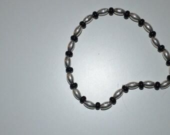 Silver and black stretch bracelet
