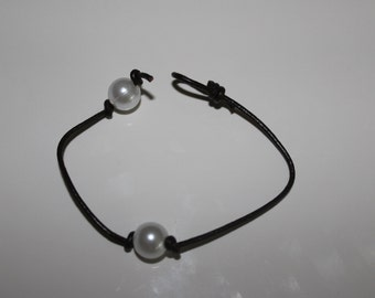 Leather bound pearl bracelet