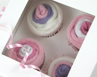 Pink baby sock cup cakes
