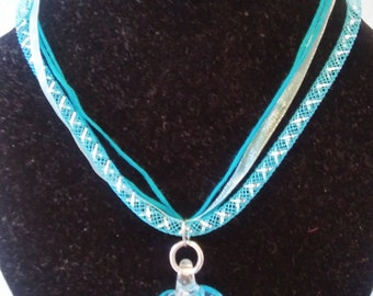 fabric necklace with glass beads and matching earrings