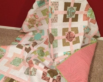 Hand pieced quilt, twin size: 75 x 86.  Pink, brown, green, aqua.  Pink chenille.
