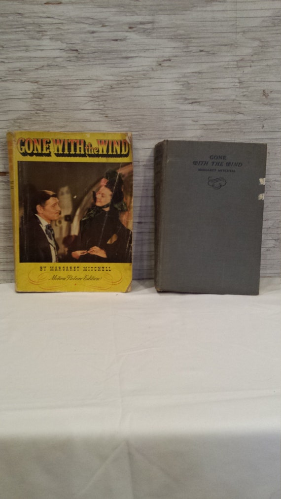 "Margaret Mitchell's ""Gone With the Wind"". The November 1938 Hard Cover Edition and 1939 Soft Cover Motion Picture Edition. Both, one money."