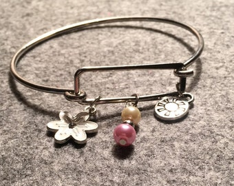 Bangle Bracelet with fresh water pearls and hand stamped flower and sun charms