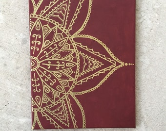 Maroon and gold flower painting