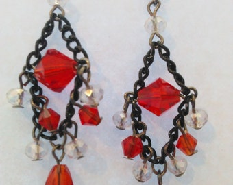 Red and black beaded chandelier earrings.
