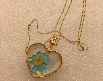 Real blue flower in resin necklace
