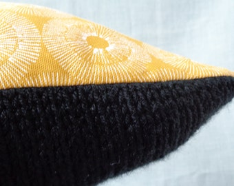 Cushion // knitted front //  black yarn // back 100% cotton fabric // ochre yellow // invisible zipper
