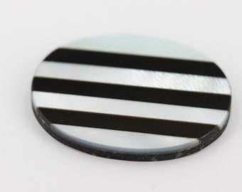 20x15 Oval Shaped Stone with Black Onyx and Mother of Pearl Straight Line Inlay