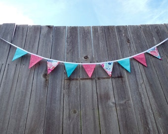 Colorful pink and blue floral double-sided fabric bunting
