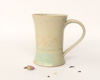 Green mug, graphic decoration, stoneware