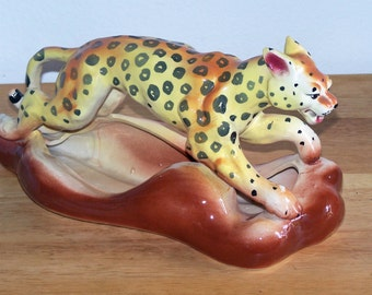 Colorful Spotted Leopard on Planter Base