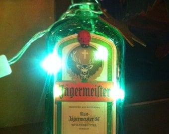 bottle of jagermeister lit