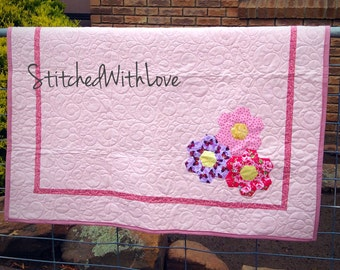 Patchwork quilt featuring Hexagon hand stitched Flowers