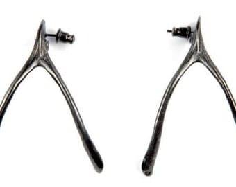 Wishbone earrings designed by Alexandra Koumba