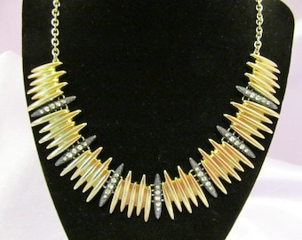 Vintage gold-toned necklace, Edgy style with black detail and rhinestones,
