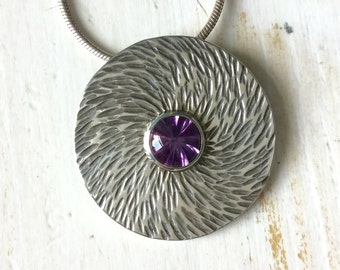 Sterling Silver and Twister cut Amethyst disc pendant with a hammered texture