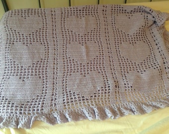 Handmade crocheted lavender baby blanket featuring hearts