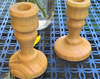 Pair of cypress candle holders