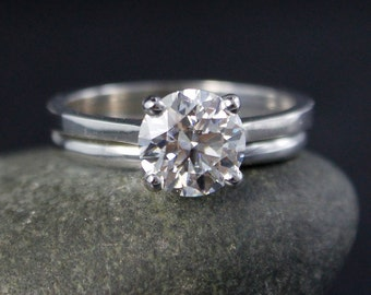 Forever One Round Brilliant Moissanite Solitaire Engagement Ring - Classic Comfort Fit Band - 14Kt White Gold