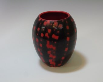 Black and red spotted vase